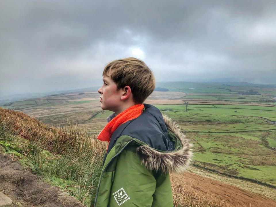 Aleks enjoying a breath of fresh air in the shadow of Pendle