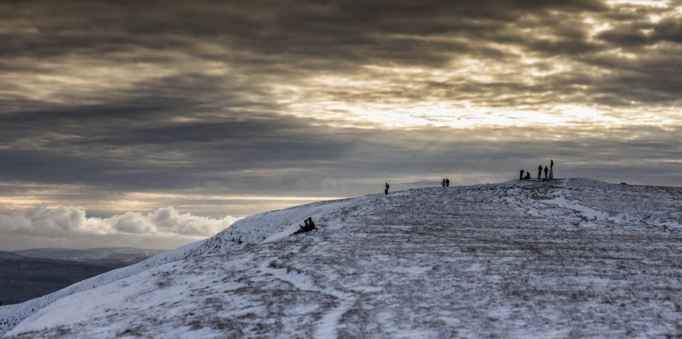 A winters afternoon at the summit of Pendle Hill