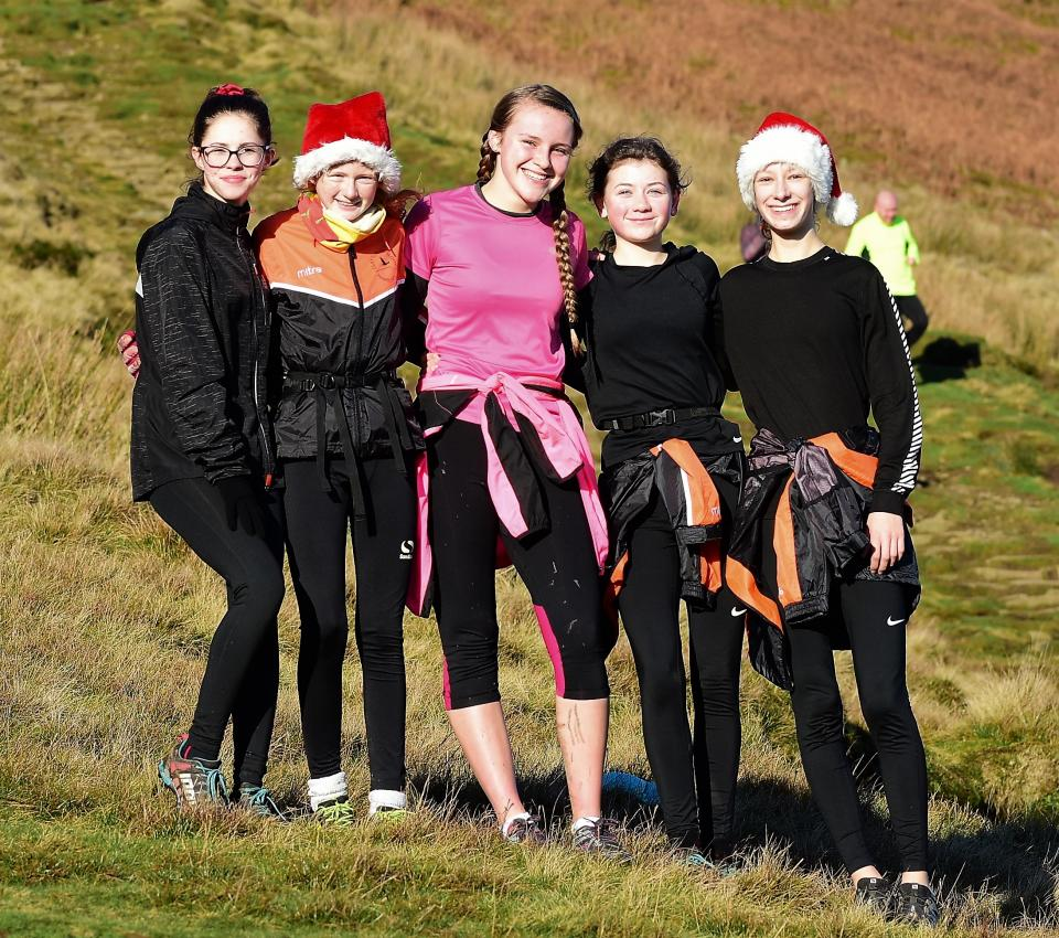 Clayton le moors harriers juniors on there tredtional Christmas run up Pendle hill.