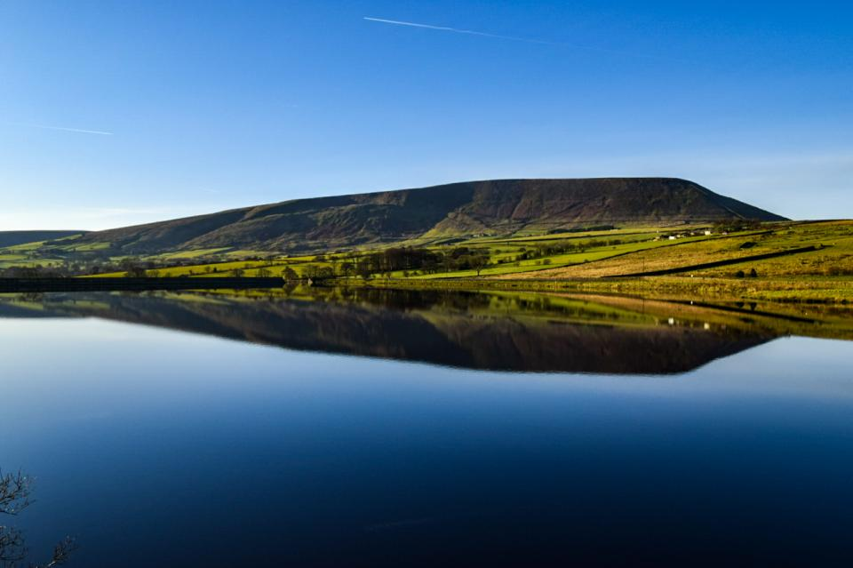 Pendle hill reflection in black moss