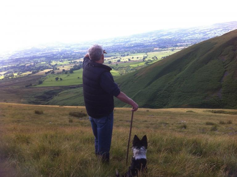 Bobbie Gill gathering the sheep off Pendle Hill Sabden, stopping to admire the view