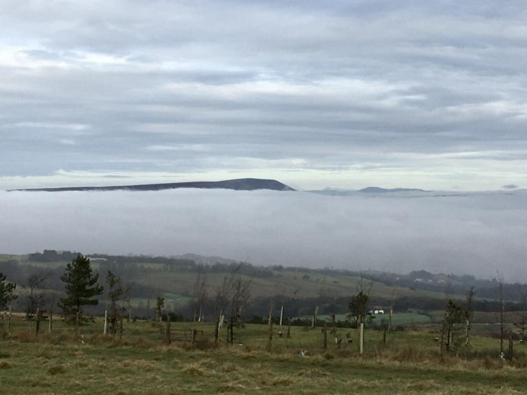 Pendle peeping out of the clouds.