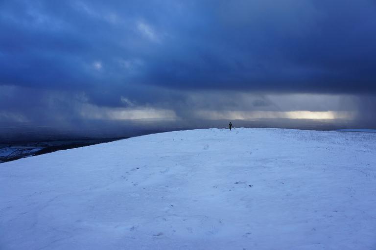 Snow filled winter skies