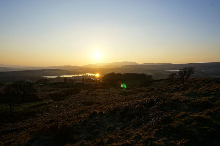 The sun sets behind Pendle Hill, from Noyna Hill above Foulridge, 28th February 2021