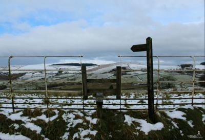 'Stile to the views' Pendle taken from a snowy Barley © Mick Hughes