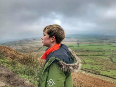 Aleks enjoying a breath of fresh air in the shadow of Pendle © Daria