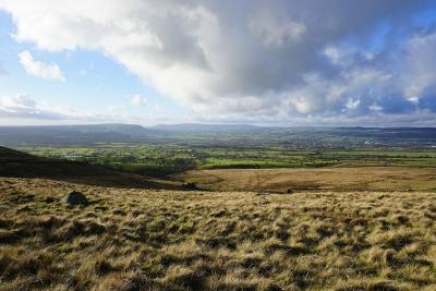 Late afternoon light across the Ribble Valley from the Nick of Pendle © Alan Kilduff
